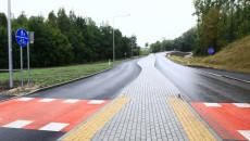 Widok nowej drogi z przejściem dla rowerów