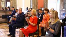 Sala lustrzana w Wojewódzkim Domu Kultury w Kielcach. Uczestnicy Konferencji siedzą na rozstawionych w rzędach, krzesłach